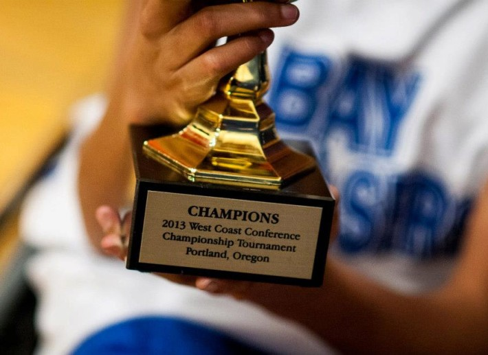 Close up of the Championship trophy.  It reads: CHAMPIONS, 2013 West Coast Conference Championship Tournament, Portland, Oregon